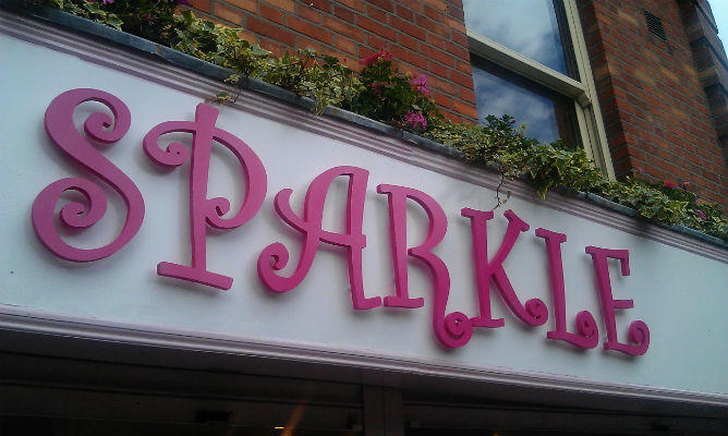 Shop front signs - Cut out and sprayed letters matched to pantone colour